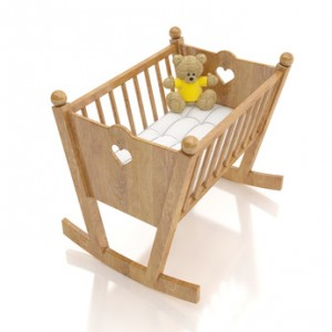 wooden baby cradle with bear toy